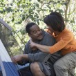 Africcouple putting up tent — Stock Photo #13220885