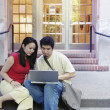 Stock Photo: Couple outside sharing laptop
