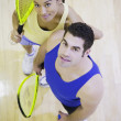 Stock Photo: High angle view of mand womwith Squash rackets