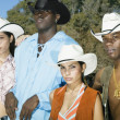 Stock Photo: Young couples in cowboy outfits posing for the camera