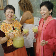 Women having mixed drinks — Stock Photo