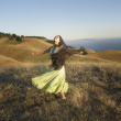 Stock Photo: Passionate womdancing on hillside