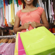 Portrait of womin clothing store with bags — Stock Photo #13221033