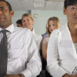 Businessman and woman in conference — Stock Photo