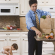 Dad after Work with Toddler and Groceries — Stock Photo