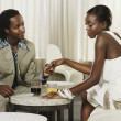 African couple holding hands at bar — Stock Photo #13221067