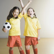 Two girls cheering in soccer outfits — Stock Photo #13221146