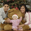Hispanic parents and baby on Christmas — Stock Photo