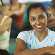 Multi-ethnic women in exercise class — Stock Photo #13221165