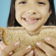 Royalty-Free Stock Photo: Young girl holding sandwich