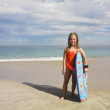 Stock Photo: Portrait of girl holding boogie board at beach