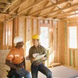 Two construction workers inside construction site — Stock Photo