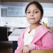 Girl sitting in kitchen at home - Foto de Stock