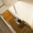 High angle view of man using laptop on stairs - Foto de Stock