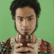 Portrait of man holding chalice - Stock Photo