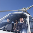 Asian businesspeople in helicopter - Stock Photo