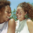 Two women laughing outdoors — Stock Photo