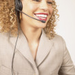 Businesswoman with telephone headset — Stock Photo