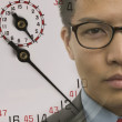 Stock Photo: Young businessman with superimposed stopwatch image