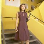 Businesswoman descending staircase — Stock Photo