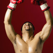 Portrait of male boxer celebrating — Stock Photo