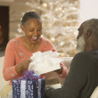 Senior African couple opening presents — Stock Photo