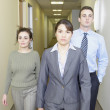 Stock Photo: Businesspeople walking in the hallway