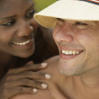 South American couple smiling at each other — Stock Photo #13221546