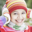 Young woman wearing a hat, scarf and gloves outdoors — Stok fotoğraf