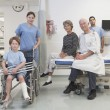 Stock Photo: Healthcare professionals and patients posing in hospital setting