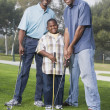 African American family playing golf — Stock Photo #13221602