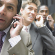 Stock Photo: Businessmen talking on cell phone