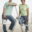 Royalty-Free Stock Photo: Portrait of Hispanic couple holding painting supplies