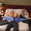 Businessman relaxing in his hotel room — Stock Photo #13221720