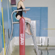 Female Asian swimmer on lifeguard chair — Stock Photo
