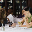 Two women talking at table in restaurant — Stock Photo