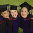 Three female graduates — Stock Photo