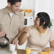 Hispanic couple having breakfast - Stock Photo