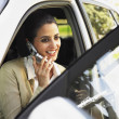 Stock Photo: Hispanic businesswoman talking on cell phone