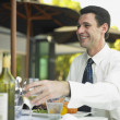 Man sitting at restaurant table — Foto de Stock