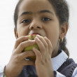 Portrait of young girl eating an apple — Stock Photo