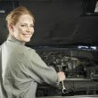 Female auto mechanic working on car — Stock Photo