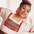 Young woman in ethnic dress dancing — Stock Photo
