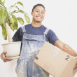 Portrait of mcarrying box and plant — Stock Photo #13221957
