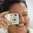 Woman with manicured nails taking a picture — Stock Photo #13221979