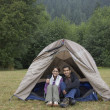 Portrait of Indian couple sitting in tent — Stock Photo