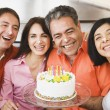 Middle-aged man celebrating birthday with friends — Stock Photo