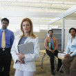 Stock Photo: Group of businesspeople in office