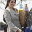 Stock Photo: Portrait of womholding groceries