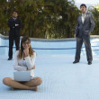 Stock Photo: South Americbusinesspeople in empty swimming pool